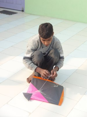 Kite teacher preparing the kite