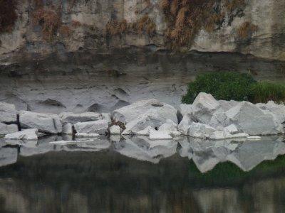 Mirrored rocks on the Li River