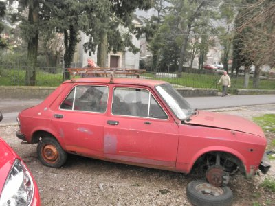 A Yugo car waiting for some attention