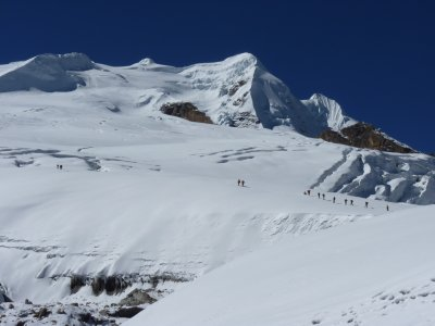 View at the glacier and the Mera Peak. You can see people hiking up the trail towards high camp (5800m) and you can see the actual Mera Peak (6476m).