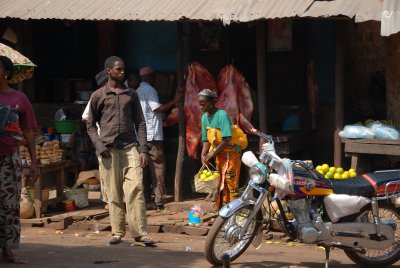 market on the way to Conakry: lots of meat. Animals hearts are put on the car for luck...