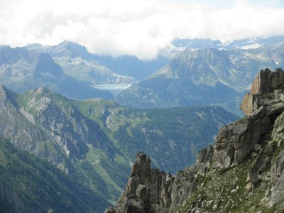 View from Fenetre d'Arpette with Lac d'emosson and the rough rock formations from the Arete de la Lys at the right hand