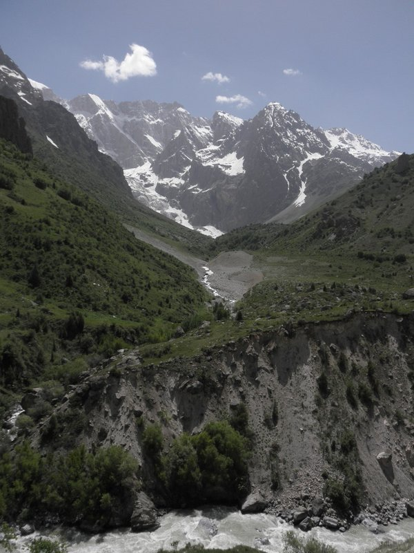 Beautiful view at the glacer, river and fresh green hills (ca 4500m)