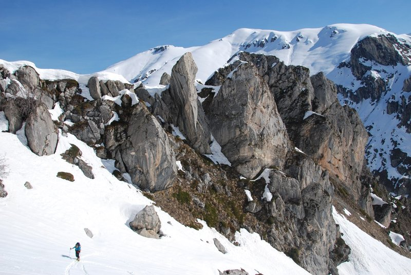 look at those rocks, look at those mountains, the snow and one skier...