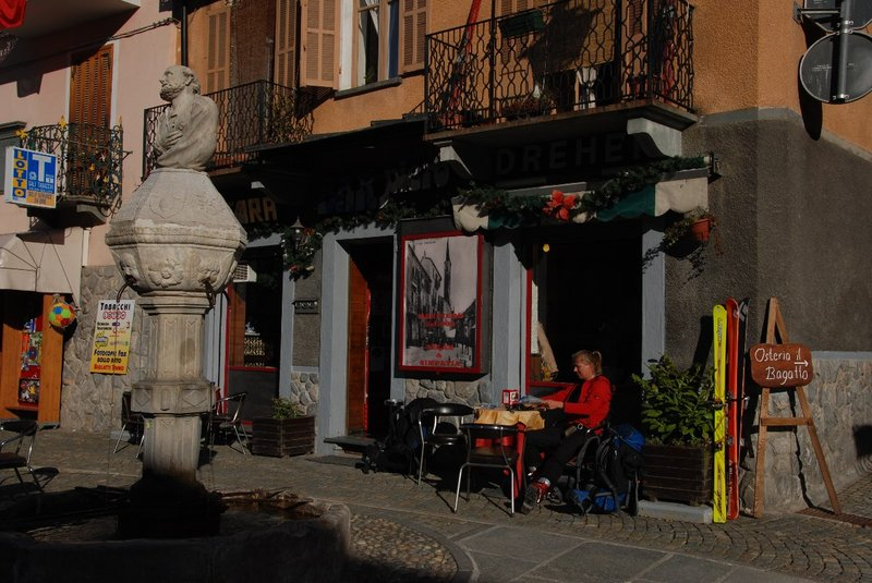 Enjoying a drink in Limone. Skis are resting aswell against the wall