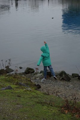 Patrick throwing stones into False Creek.