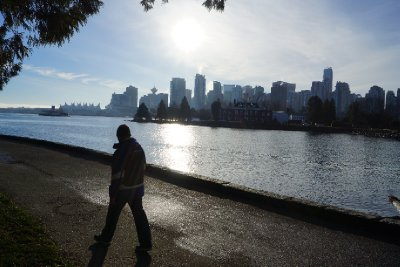 Paul walking the Seawall in Stanley Park with Vancouver downtown in the background.