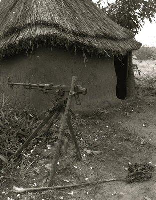 Rusted machine gun at border post