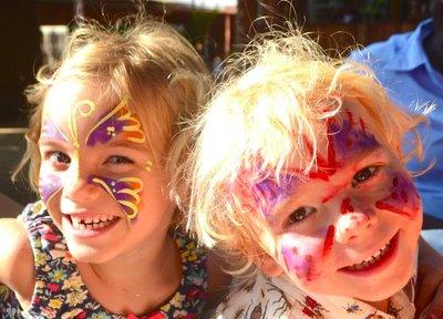 Kids got their faces painted at the Arua Christmas trade fair