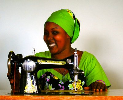 Tailor with lovely homemade kitenge outfit