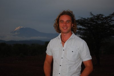 Mt Kili poses behind me posing