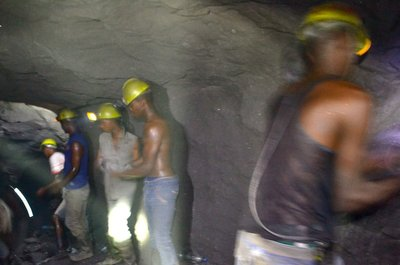Miners haul rock out of the mine