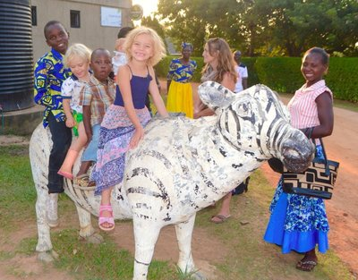 Kids on a random zebra at the Christmas meal
