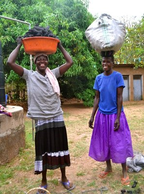 These ladies carry 30kg bags of charcoal for sale