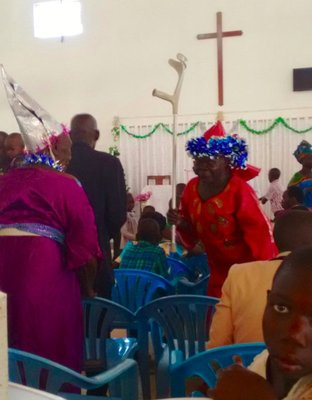 Dancing old women in church on Christmas day