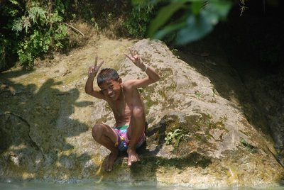 A youngster posing at one of the upper falls