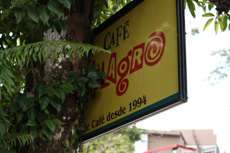 Cafe Milagro (obstructed) sign