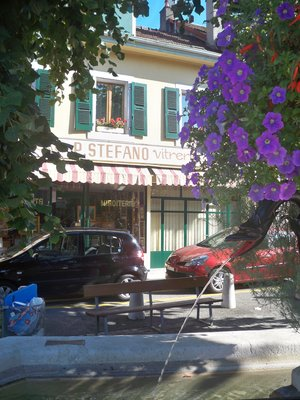 Carouge: fountain, green shutters, eurocars