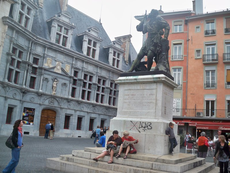 Medieval square with statue of knight