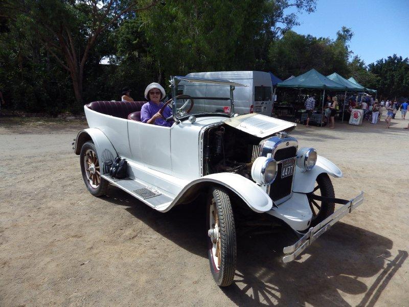 2013 Sep 8 Hiroe driving an old car at Markets