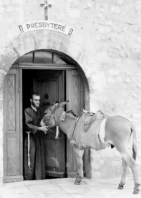 Monk and donkey at the Presbytère