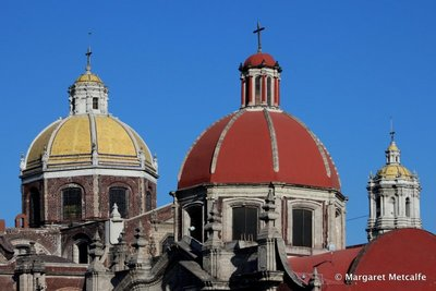 Red and yellow domes of the Basilica