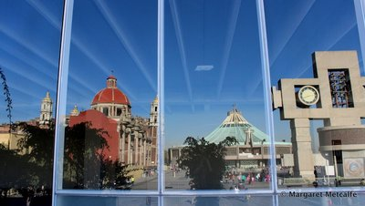 Reflection of the Basilicas in window