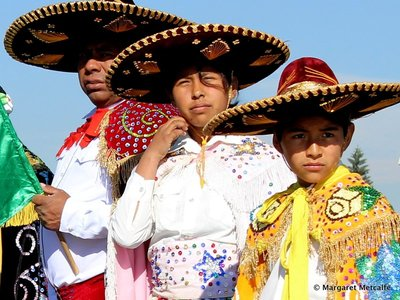 Boys wearing mariachi hats