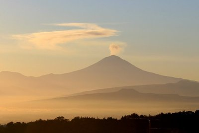 The volcano Popocatépetl letting off a bit of steam at sunrise