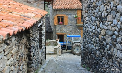 Stone houses with red roofs