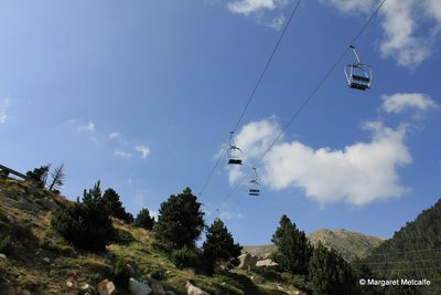 Chair lifts suspended in the sky
