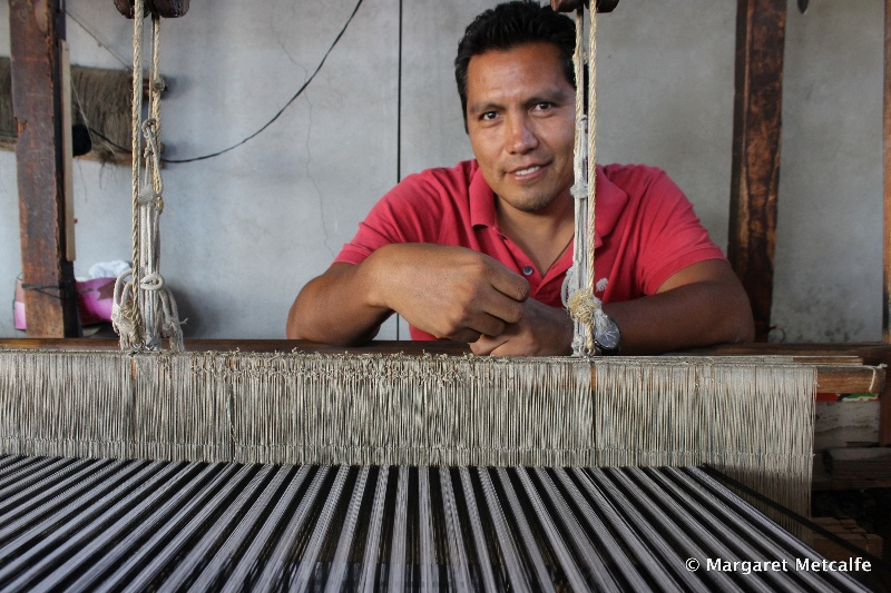 Working at his loom weaving shawls