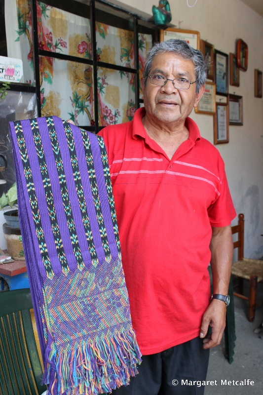 Master weaver with one of his creations