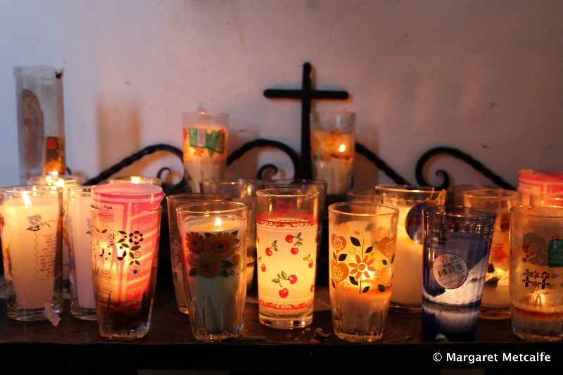 Candles alight in church