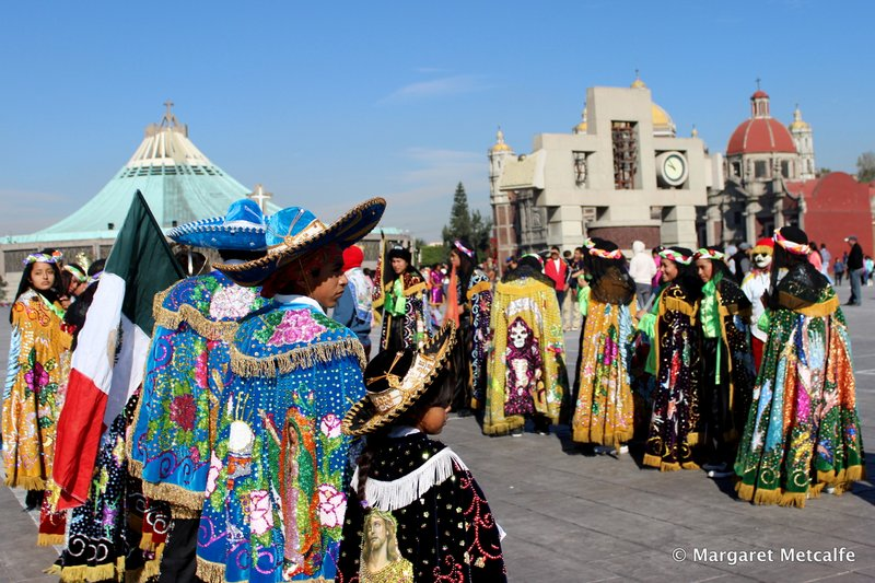 Dancers in mariachi hats and capes