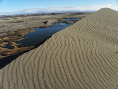 Sand Ripples and the Sharp Edge of the High Dune