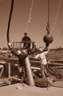 Workers Building The Bridge