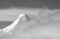 Mountain Peak and Passing Clouds