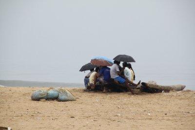 enjoy the beach during the rain