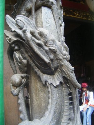 Pillar with dragon feature round it, Buddhist temple, Cholon, Saigon