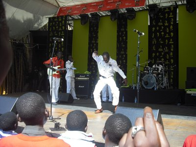 One of the musicians dancing at the Sulumani Chimbetu and the Orchestra Dendera Kings show, HIFA