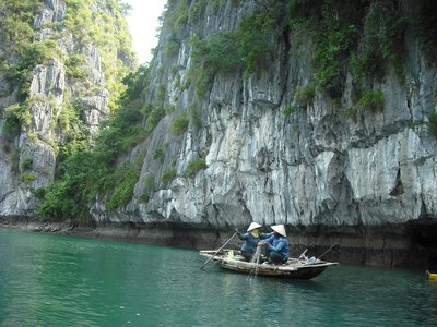 Vietnamese women casting the nets for fish, Halong Bay