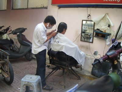 Open air barber, Saigon