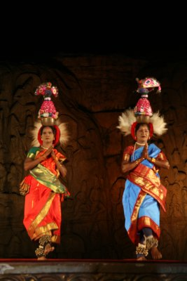 Funny Ladies dancing with pots on head