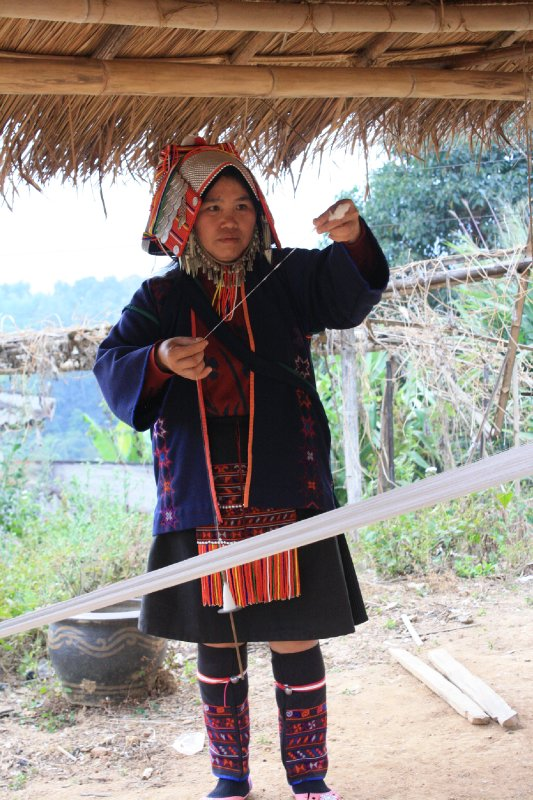 Akha hill tribe spinning yarn