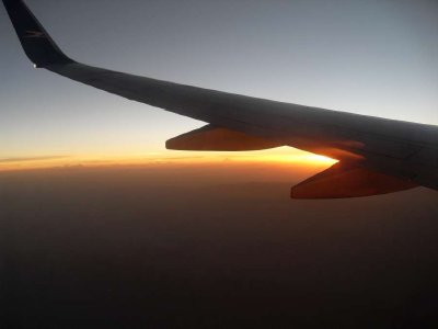 Sunset wing plane photo