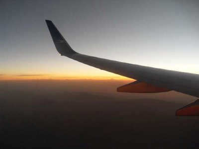 Normal zoom level reverted plane wing and sunset