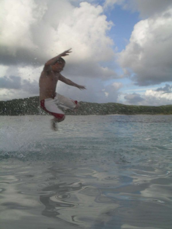 Jumping into Lake MacKenzie