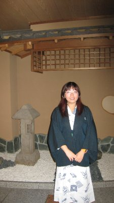 Mi in Yukata, standing outside the restaurant