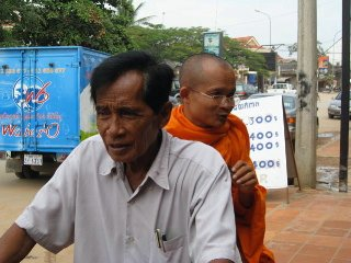 Monk on bike smoking a cigar